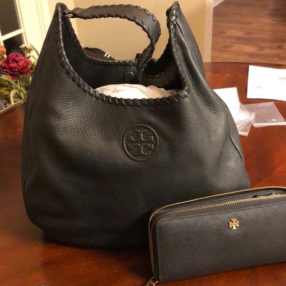 e7f3550f12d2 Tory Burch handbag and matching wristlet.